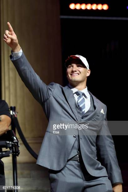 Mitchell Trubisky of North Carolina reacts after being picked overall by the Chicago Bears during the first round of the 2017 NFL Draft at the...