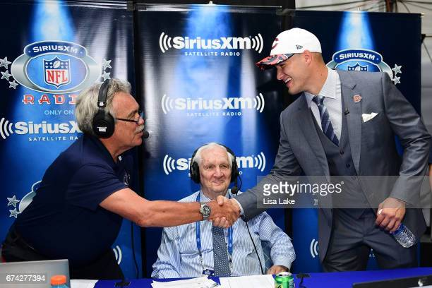 Mitchell Trubisky of North Carolina shakes hands with hosts Pat Kirwan and Gil Brandt of the SiriusXM NFL Radio talkshow after being picked overall...