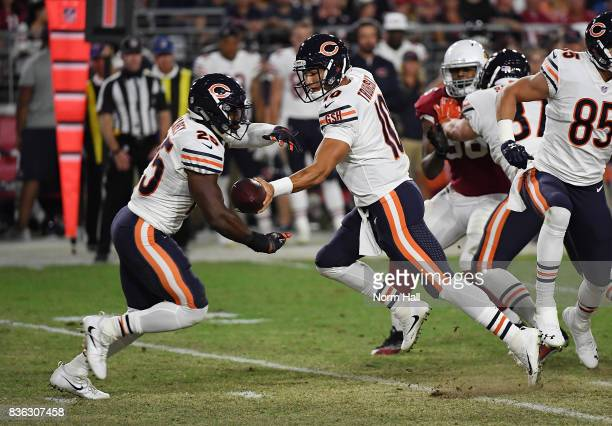 Mitchell Trubisky of the Chicago Bears hands the ball off to teammate Ka'Deem Carey during a game against the Arizona Cardinals at University of...