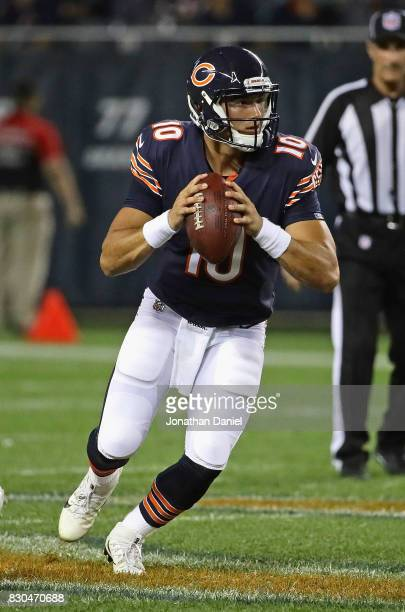 Mitchell Trubisky of the Chicago Bears looks for a receiver against the Denver Broncos during a preseason game at Soldier Field on August 10 2017 in...