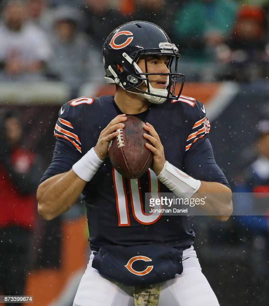 Mitchell Trubisky of the Chicago Bears looks for a receiveragainst the Green Bay Packers at Soldier Field on November 12 2017 in Chicago Illinois The...