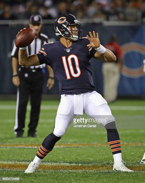 Mitchell Trubisky of the Chicago Bears passes against the Denver Broncos during a preseason game at Soldier Field on August 10 2017 in Chicago...