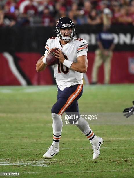 Mitchell Trubisky of the Chicago Bears rolls out while looking to throw the ball against the Arizona Cardinals at University of Phoenix Stadium on...