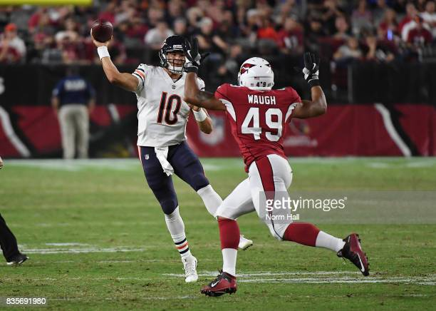 Mitchell Trubisky of the Chicago Bears throws a pass by Terence Waugh of the Arizona Cardinals during the second half at University of Phoenix...