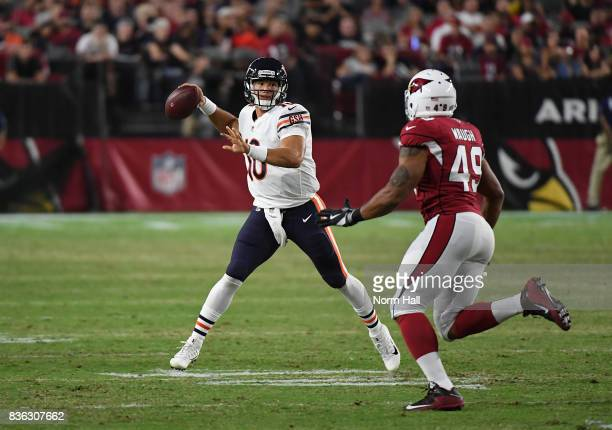 Mitchell Trubisky of the Chicago Bears throws a pass while being chased by Terence Waugh of the Arizona Cardinals during the second half at...