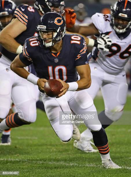 Mitchell Trubisky of the Chicago Bears turns to hand off against the Denver Broncos during a preseason game at Soldier Field on August 10 2017 in...