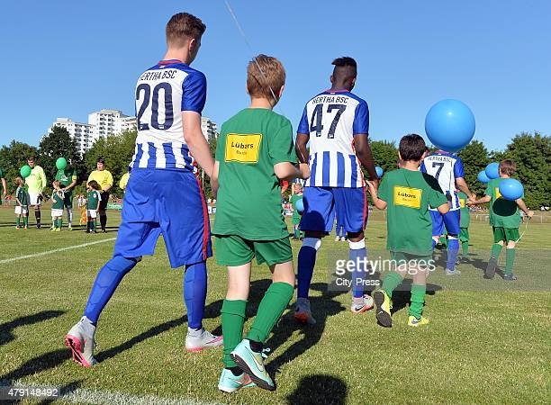 Mitchell Weiser and Jordan Torunarigha of Hertha BSC enter the pitch during the game between dem 1 FC Luebars and Hertha BSC on July 1 2015 in Berlin...
