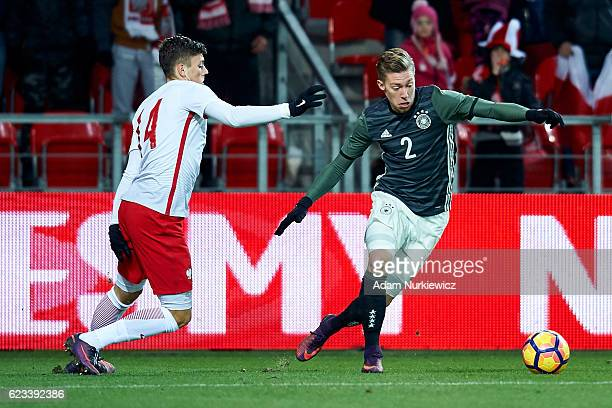 Mitchell Weiser from Germany fights for the ball with Dawid Kownacki from Poland during the International Friendly soccer match between Poland U21...