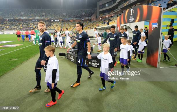 Mitchell Weiser Karim Rekik Valentino Lazaro and Davie Selke of Hertha BSC with entry children before the Europa League group J game between Zorya...