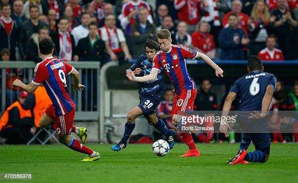Mitchell Weiser of Bayern Muenchen battles for the ball with Oliver Torres during the UEFA Champions League Quarter Final Second Leg match between FC...