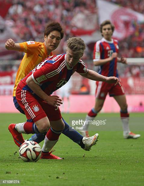 Mitchell Weiser of Bayern Muenchen fights for the ball with Genki Haraguchi of Hertha BSC during the Bundesliga match between FC Bayern Muenchen and...