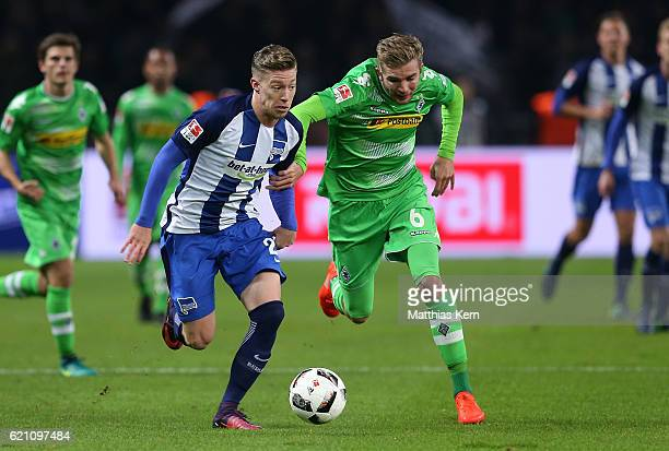 Mitchell Weiser of Berlin battles for the ball with Christoph Kramer of Moenchengladbach during the Bundesliga match between Hertha BSC and Borussia...
