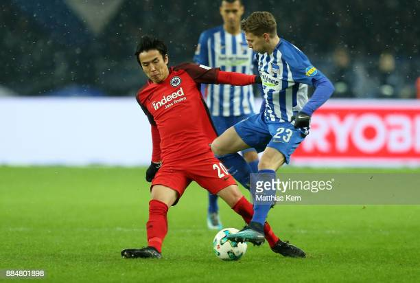 Mitchell Weiser of Berlin battles for the ball with Makoto Hasebe of Frankfurt during the Bundesliga match between Hertha BSC and Eintracht Frankfurt...
