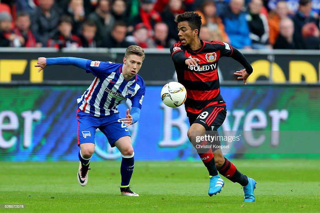 Mitchell Weiser of Berlin challenges Benjamin Henrichs of Leverkusen during the Bundesliga match between Bayer Leverkusen and Hertha BSC Berlin at BayArena on April 30, 2016 in Leverkusen, Germany.