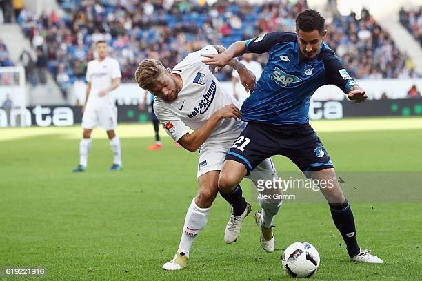 Mitchell Weiser of Berlin is challenged by Benjamin Huebner of Hoffenheim during the Bundesliga match between TSG 1899 Hoffenheim and Hertha BSC at...