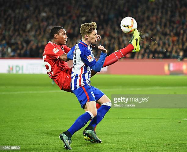 Mitchell Weiser of Berlin is challenged by Salif Sane of Hannover during the Bundesliga match between Hannover 96 and Hertha BSC at HDIArena on...