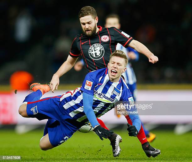 Mitchell Weiser of Berlin is tackled by Marc Stendera of Frankfurt during the Bundesliga match between Hertha BSC and Eintracht Frankfurt at...