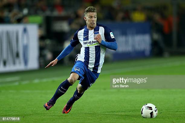 Mitchell Weiser of Berlin runs with the ball during the Bundesliga match between Borussia Dortmund and Hertha BSC at Signal Iduna Park on October 14...