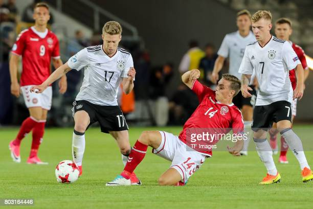 Mitchell Weiser of Germany and Casper Nielsen of Denmark battle for the ball during the UEFA European Under21 Championship Group C match between...