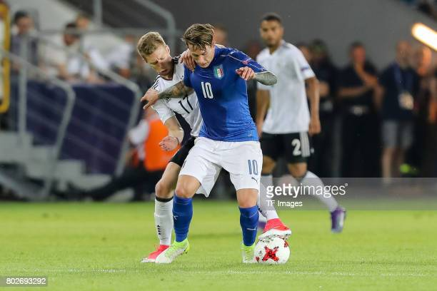 Mitchell Weiser of Germany and Federico Bernardeschi of Italy battle for the ball during the UEFA U21 championship match between Italy and Germany at...