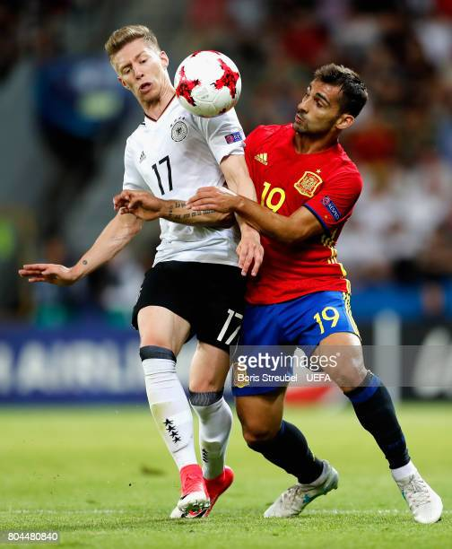 Mitchell Weiser of Germany and Jonny of Spain battle for possession during the UEFA European Under21 Championship Final between Germany and Spain at...