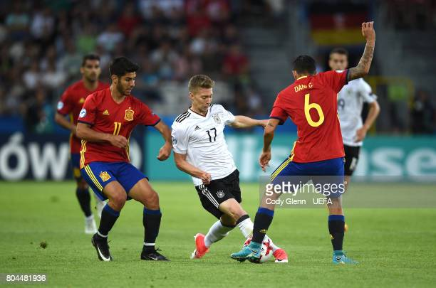 Mitchell Weiser of Germany and Marco Asensio left and Dani Ceballos of Spain during their UEFA European Under21 Championship 2017 final match on June...