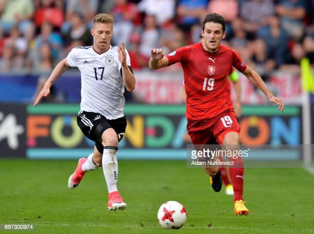 Mitchell Weiser of Germany and Milan Havel of Czech Repulic battle for possession during the UEFA European Under21 Championship Group C match between...