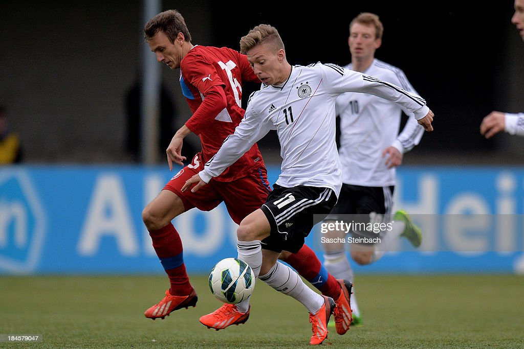 Mitchell Weiser (R) of Germany battles for the ball with Simon Falta (L) of Czech Republic during the U20 juniors tournament match between the Czech Republic and Germany on October 14, 2013 in Gemert, Netherlands.
