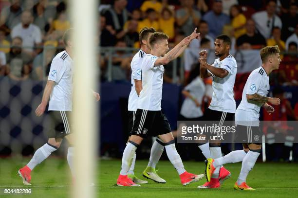 Mitchell Weiser of Germany celebrates scoring his sides first goal with his Germany team mates during the UEFA European Under21 Championship Final...