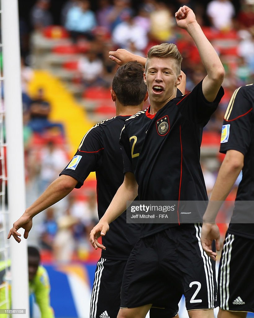 Mitchell Weiser of Germany celebrates with <a gi-track='captionPersonalityLinkClicked' href=/galleries/search?phrase=Samed+Yesil&family=editorial&specificpeople=5945598 ng-click='$event.stopPropagation()'>Samed Yesil</a> after scoring during the Group E FIFA U-17 World Cup match between Burkina Faso and Germany at the Corregidora Stadium on June 23, 2011 in Queretaro, Mexico.