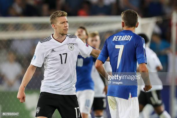 Mitchell Weiser of Germany Domenico Berardi of Italy during the UEFA U21 championship match between Italy and Germany at Krakow Stadium on June 24...