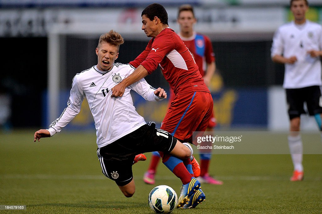 Mitchell Weiser of Germany is brought down by Lukas Landovsky of Czech Republic during the U20 juniors tournament match between the Czech Republic and Germany on October 14, 2013 in Gemert, Netherlands.