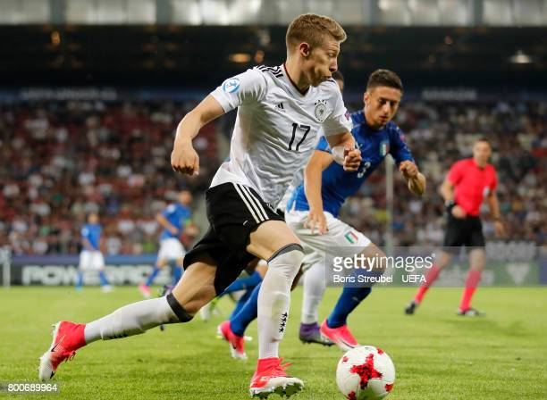 Mitchell Weiser of Germany is challenged by Antonio Barreca of Italy during the UEFA European Under21 Championship Group C match between Italy and...