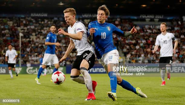 Mitchell Weiser of Germany is challenged by Federico Bernardeschi of Italy during the UEFA European Under21 Championship Group C match between Italy...