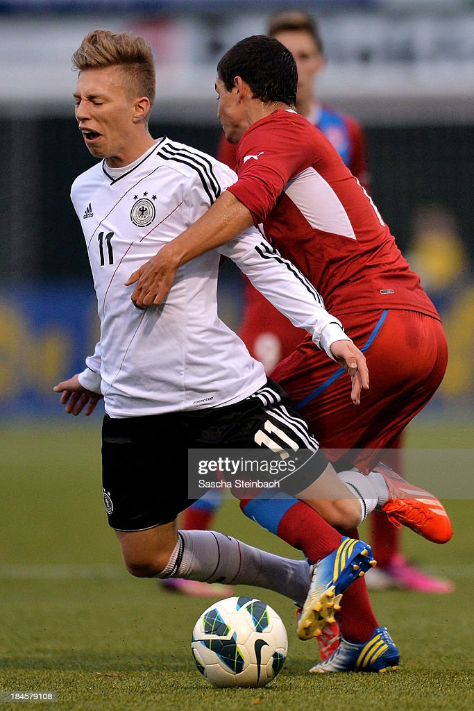 Mitchell Weiser of Germany is tackled by Lukas Landovsky of Czech Republic during the U20 juniors tournament match between the Czech Republic and Germany on October 14, 2013 in Gemert, Netherlands.