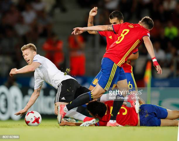 Mitchell Weiser of Germany is tackled by players of Spain during the UEFA European Under21 Championship Final match between Germany and Spain at...