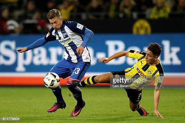 Mitchell Weiser of Hertha Berlin is challenged by Emre Mor of Dortmund during the Bundesliga match between Borussia Dortmund and Hertha BSC at Signal...
