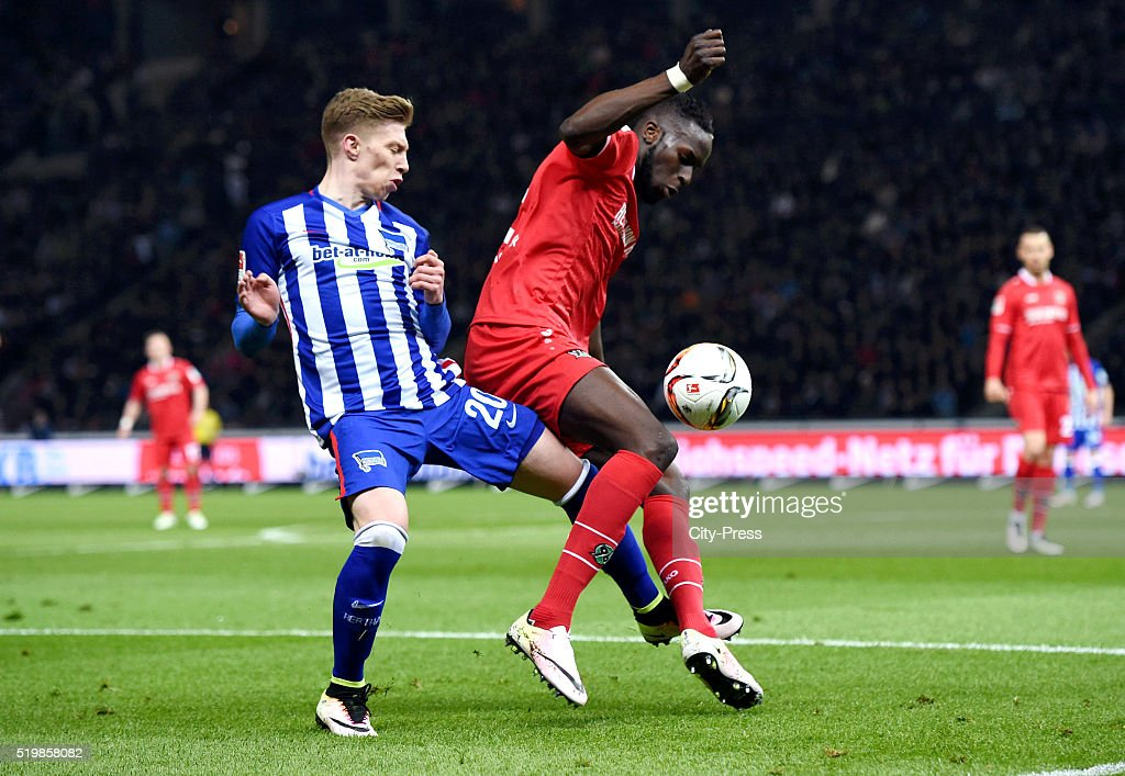 Mitchell Weiser of Hertha BSC and Salif Sane of Hannover 96 during the Bundesliga match between Hertha BSC and Hannover 96 at Olympiastadion on April 8, 2016 in Berlin, Germany.