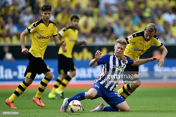 Mitchell Weiser of Hertha BSC is challenged by Marcel Schmelzer of Borussia Dortmund during the Bundesliga match between Borussia Dortmund and Hertha...