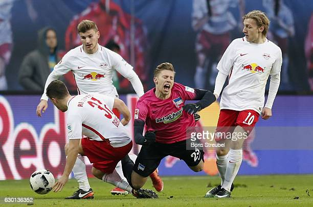 Mitchell Weiser of Hertha BSC is fouled by Diego Demme of RB Leipzig during the Bundesliga match between RB Leipzig and Hertha BSC at Red Bull Arena...