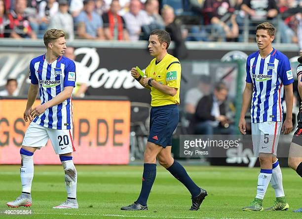 Mitchell Weiser of Hertha BSC referee Benjamin Brand and Niklas Starke of Hertha BSC during the game between Eintracht Frankfurt and Hertha BSC on...