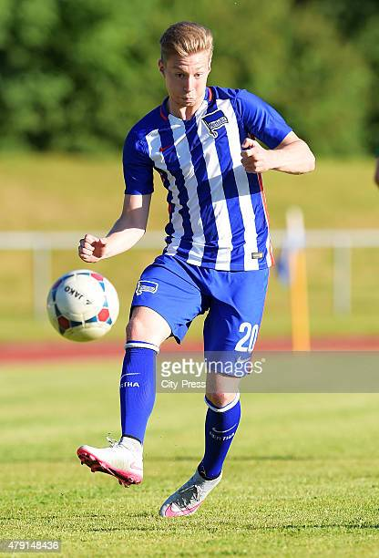 Mitchell Weiser of Hertha BSC shoots the ball during the game between dem 1 FC Luebars and Hertha BSC on July 1 2015 in Berlin Germany