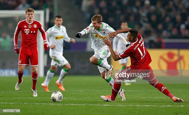 Mitchell Weiser of Moenchengladbach is challenged by Jerome Boateng of Muenchen during the Bundesliga match between Borussia Moenchengladbach and FC...
