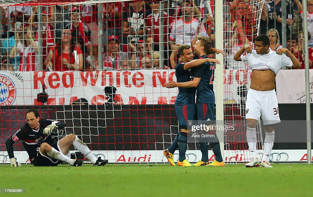 Mitchell Weiser of Muenchen celebrates his team's second goal with team mate <a gi-track='captionPersonalityLinkClicked' href=/galleries/search?phrase=Xherdan+Shaqiri&family=editorial&specificpeople=6923918 ng-click='$event.stopPropagation()'>Xherdan Shaqiri</a> as Reinaldo and goalkeeper <a gi-track='captionPersonalityLinkClicked' href=/galleries/search?phrase=Rogerio+Ceni&family=editorial&specificpeople=490994 ng-click='$event.stopPropagation()'>Rogerio Ceni</a> of Sao Paulo reacts during the Audi Cup match between FC Bayern Muenchen and FC Sao Paulo at Allianz Arena on July 31, 2013 in Munich, Germany.