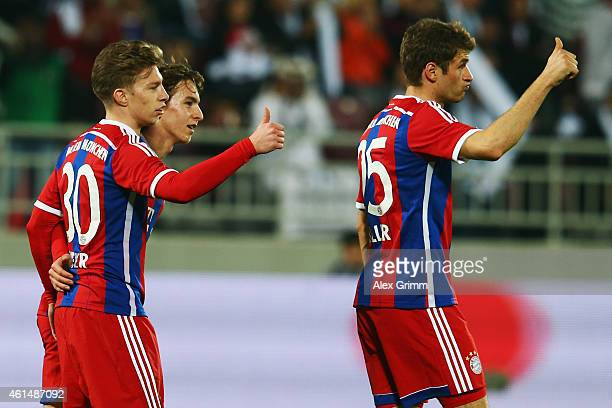 Mitchell Weiser of Muenchen celebrates his team's second goal with team mate Thomas Mueller during a friendly match between FC Bayern Muenchen and...