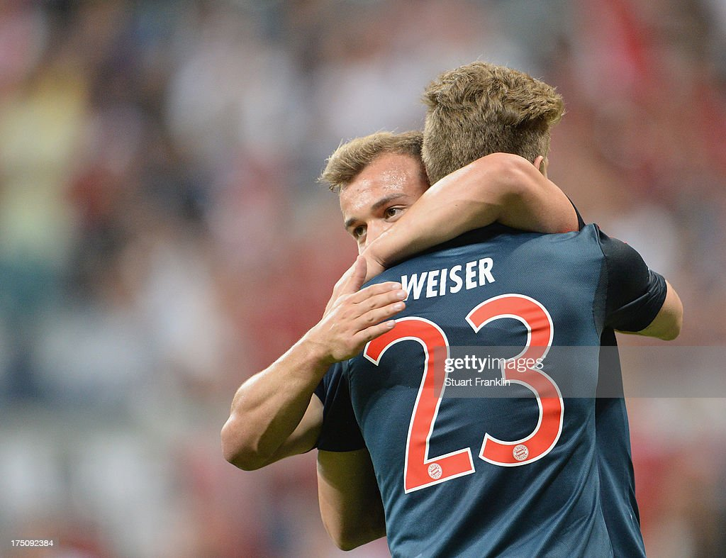 Mitchell Weiser of Muenchen celebrates scoring his goal with <a gi-track='captionPersonalityLinkClicked' href=/galleries/search?phrase=Xherdan+Shaqiri&family=editorial&specificpeople=6923918 ng-click='$event.stopPropagation()'>Xherdan Shaqiri</a> during the Audi cup match between FC Bayern Muenchen and FC Sao Paulo at Allianz Arena on July 31, 2013 in Munich, Germany.