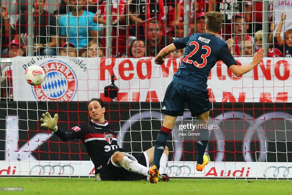 Mitchell Weiser of Muenchen scores his team's second goal against goalkeeper <a gi-track='captionPersonalityLinkClicked' href=/galleries/search?phrase=Rogerio+Ceni&family=editorial&specificpeople=490994 ng-click='$event.stopPropagation()'>Rogerio Ceni</a> of Sao Paulo during the Audi Cup match between FC Bayern Muenchen and FC Sao Paulo at Allianz Arena on July 31, 2013 in Munich, Germany.