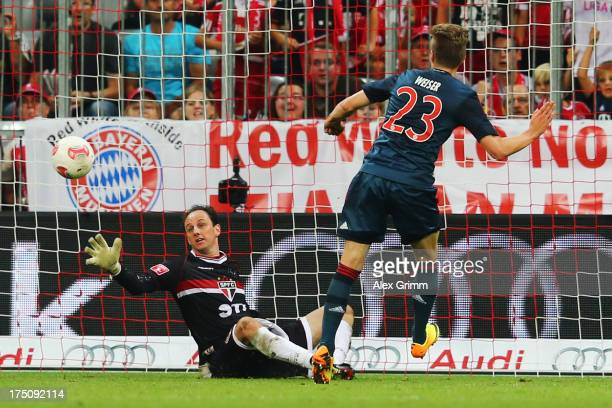 Mitchell Weiser of Muenchen scores his team's second goal against goalkeeper Rogerio Ceni of Sao Paulo during the Audi Cup match between FC Bayern...