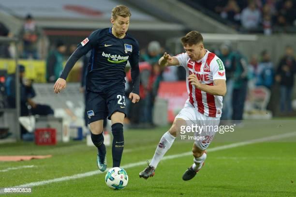 Mitchell Weiser Salih Oezcan of Koeln battle for the ball during the Bundesliga match between 1 FC Koeln and Hertha BSC at RheinEnergieStadion on...