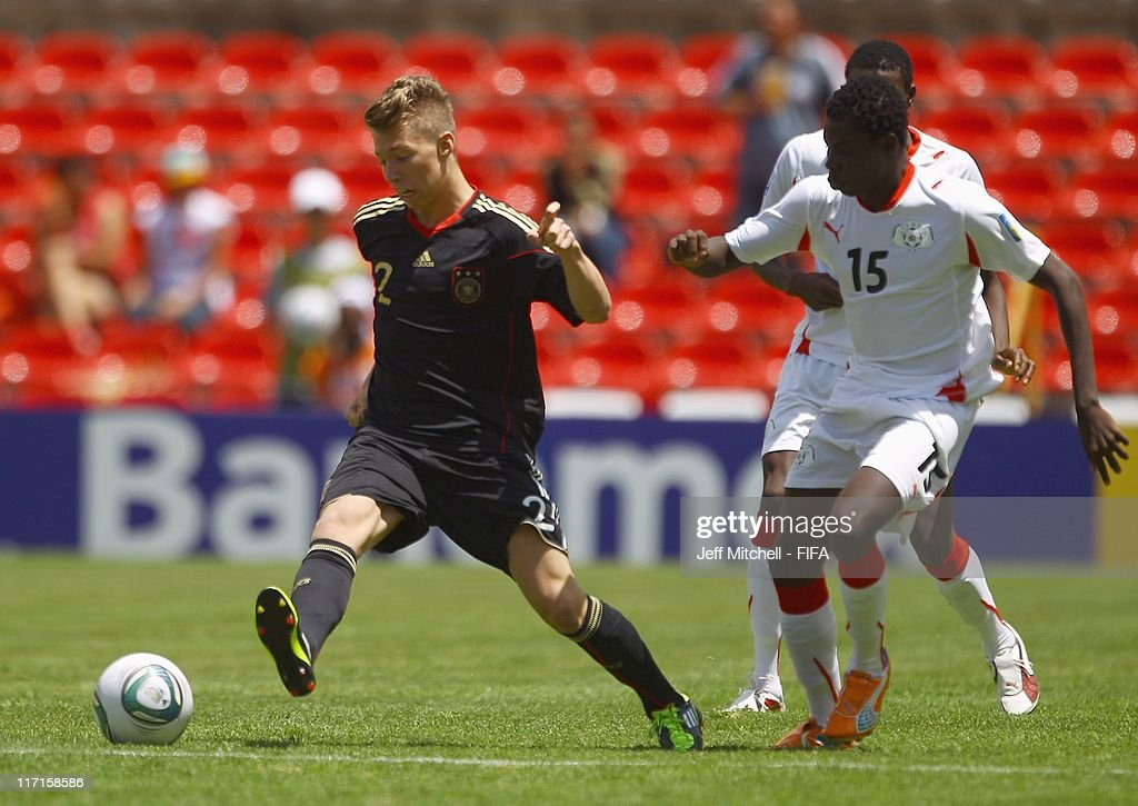 Mitchell Weisser of Germany is challenged by Romaric Pitriopa (R) of Burkina Faso during the Group E FIFA U-17 World Cup match between Burkina Faso and Germany at the Corregidora Stadium on June 23, 2011 in Queretaro, Mexico.